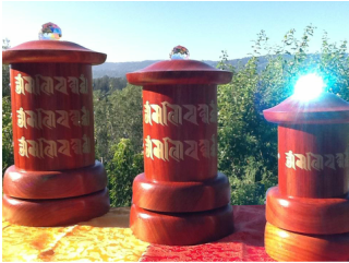 Three table top prayer wheels